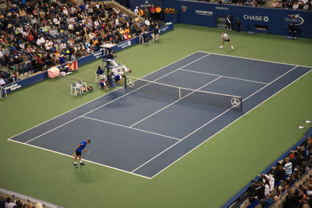 tennis stadium: New York - September 9, 2010: A crowded Arthur Ashe Stadium for a night U.S. Open tennis match in Queens, New York City.