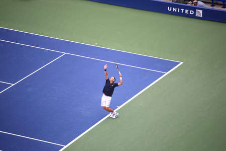 New York - September 7, 2011: Gilles Muller of Luxembourg serves to Rafael Nadal of Spain in Arthur Ashe Stadium during the 2011 US Open Tennis Tournament.
