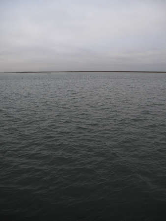 murky: Bay and Distant Horizon - Simple dark bay water and cloudy sky.
