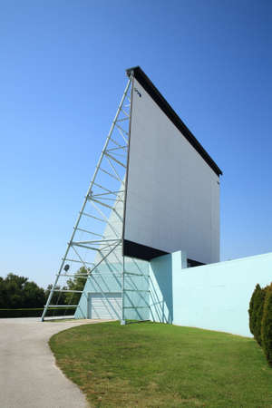 Drive-In theater movie screen against a sunny blue sky. Stock Photo - 11400759