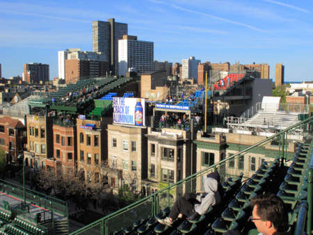 cubs: Chicago, Illinois - April 26, 2010: Sheffield Avenue rooftop seats at Wrigley Field for Chicago Cubs baseball fans.