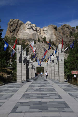 Mount Rushmore, South Dakota - September 26, 2008: Mt. Rushmore, including tourists, flags and visitors center Grand View Terrace.