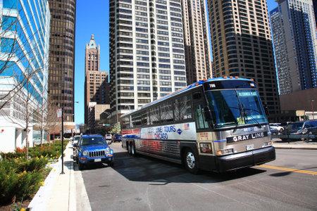 tour bus: Chicago, Illinois - April 26, 2010: Chicago city street scene with tour bus.