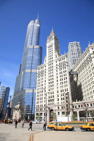 Chicago, Illinois - April 26, 2010: Michigan Avenue in Chicago, with the Wrigley Building and pedestrians.