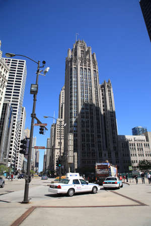 Chicago, Illinois - April 26, 2010: Michigan Avenue in Chicago, with the Tribune Building and pedestrians.