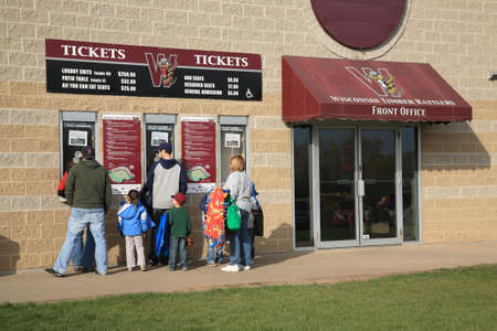 Grand Chute, Wisconsin - April 23, 2010: Minor League Baseball Wisconsin Timber Rattlers fans buy tickets. Editöryel
