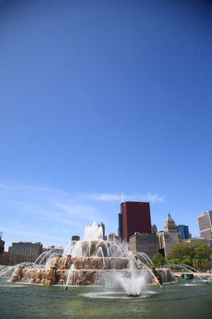 Chicago, Illinois - April 26, 2010: Buckingham Fountain in Grant Park with skyscrapers in background. With copy space.