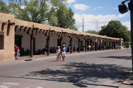 Santa Fe, New Mexico - September 15, 2008: Shoppers and tourists at the Native American market in the Palace of the Governors.