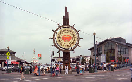 west gate: San Francisco, California - September 20, 2007: Tourists at the famous Fishermans Wharf sign.