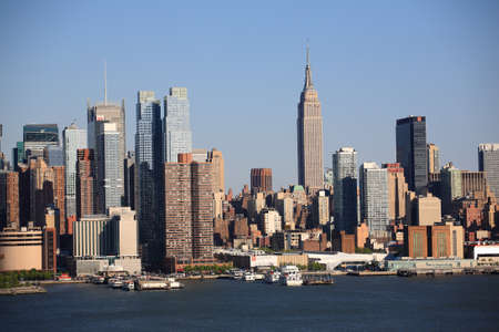 New York - April 29, 2012: The busy Manhattan city skyline on the Hudson River.