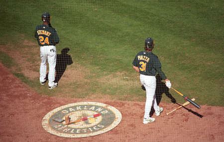 Oakland, California - September 19, 2007: Mike Piazza and Shannon Stewart on deck during an A's baseball game at Oakland Coliseum. Stock Photo - 13669366