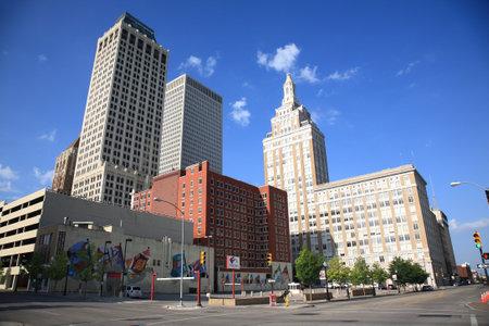 street corner: Tulsa, Oklahoma - June 23, 2012: Tulsa Skyline and street scene. The city is known for its Art Deco buildings.