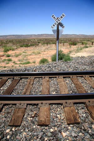 Railroad Tracks and Crossing Sign photo
