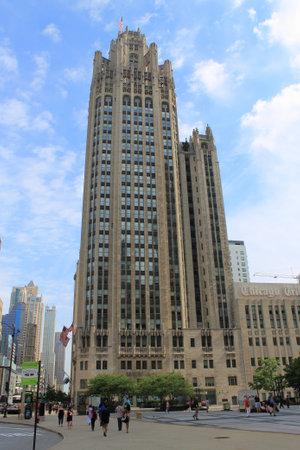 Chicago - June 18, 2012: Chicago Tribune Tower on Michigan Avenue. Street scene with pedestrians.