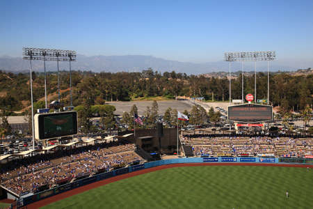 baseball crowd: Los Angeles - June 30, 2012: Scoreboards and bleachers at a Dodgers baseball game at Dodger Stadium.
