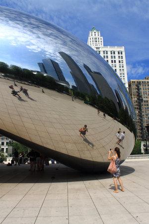 warped: Chicago - June 18, 2012: Chicago Cloud Gate sculpture in Millennium Park, known as the Bean.