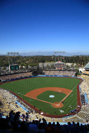 stadium crowd: Los Angeles - June 30, 2012: A sunny day Dodgers baseball game at Dodger Stadium.