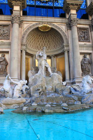 roman empire: Las Vegas - July 2, 2012: Statue and pool at Caesars Palace Hotel and Casino on the famous Strip.