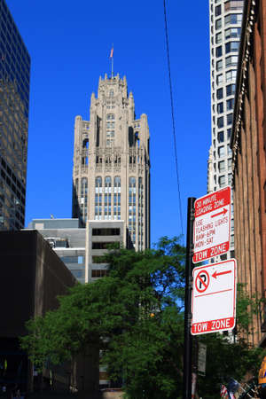 Chicago - June 17, 2012: Chicago traffic signs with Tribune building as background.