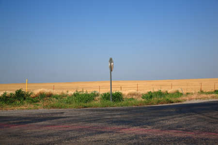 Rural Road - A countryside intersection with bright landscape and copy space  photo