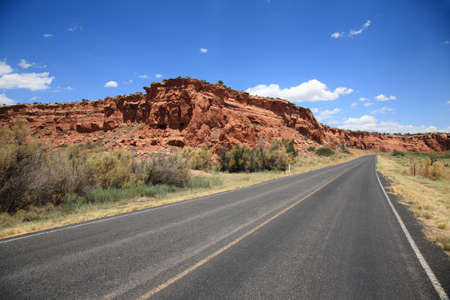 Mountain Road heads towards a mountain in Southwestern United States Banco de Imagens