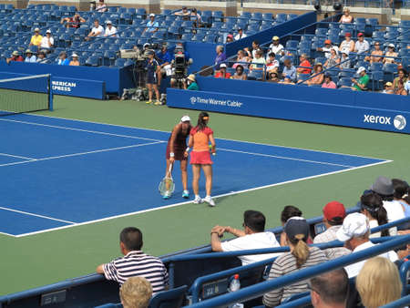 louis armstrong: Flushing, New York - September 3, 2014: Andrea Hlavackova (facing) and Zheng Jie at Louis Armstrong Stadium, during the 2014 US Open Tennis Championships. Editorial