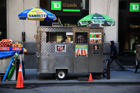 market vendor: New York - March 27, 2013:  Food stand on a Manhattan street. Editorial