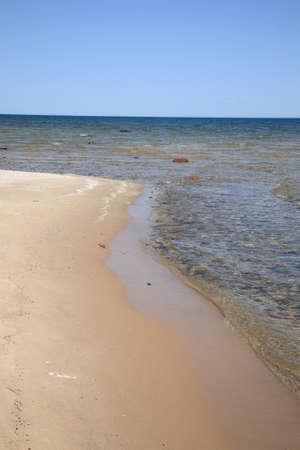 Seashore - Lake Huron. Waves reach long rocky shoreline beach of Great Lakes in Michigan
