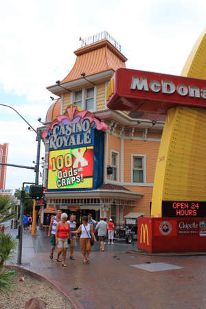 Las Vegas - July 4, 2012: Pedestrians on the Las Vegas Strip near the Casino Royale and a McDonalds.