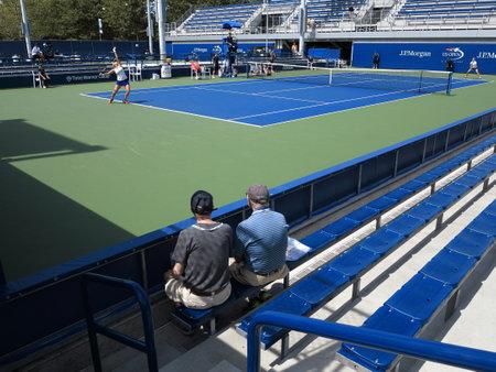 Flushing, New York - September 3, 2014: A women\'s singles junior match at the 2014 US Open Tennis Championships. Nadia Podoroska serves to Caroline Dolehide.