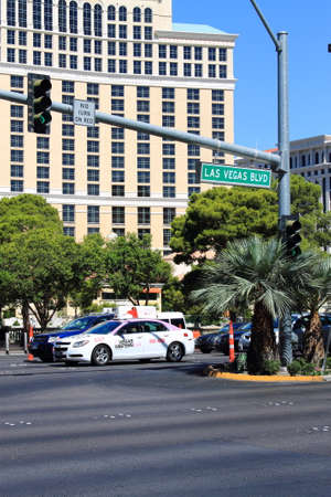 sightseers: Las Vegas - July 3, 2012: Busy traffic on Las Vegas Boulevard, the famous Strip.