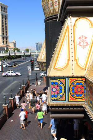 sightseers: Las Vegas - July 3, 2012: Tourists and sightseers on the famous Strip near the Cromwell Hotel in Las Vegas.