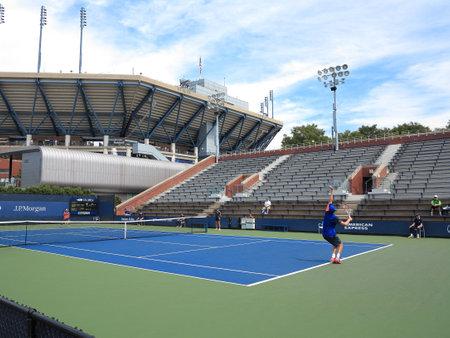 flushing: Flushing, New York - September 3, 2014: Reilly Opelka of the USA serves to Seong-Chan Hong of Korea during a 2014 U.S. Open junior match.