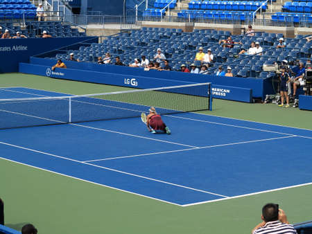 Flushing, New York - September 3, 2014: Andrea Hlavackova crouches at Louis Armstrong Stadium, during the 2014 US Open Tennis Championships.