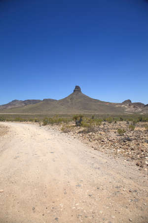 southwest: Mountain and Desert Landscape - Dirt road in the American Southwest.
