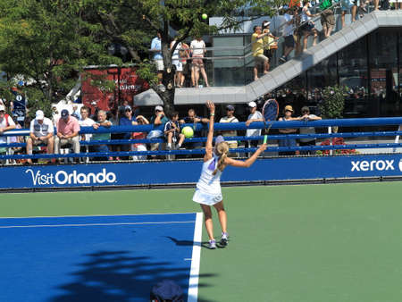 louis armstrong: Flushing, New York - September 3, 2014: Katherine Sebov of Canada serving at a junior match at the 2014 US Open Tennis Championships.