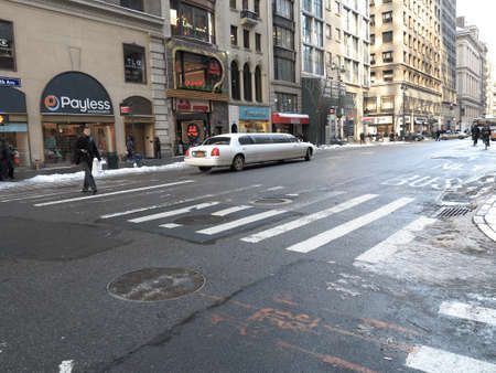 manhole cover: New York - March 6, 2015: Wide 5th Avenue crossing in New York City. Editorial