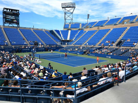 us open: Flushing, New York - September 3, 2014: Doubles match at Louis Armstrong Stadium, during the 2014 US Open Tennis Championships.