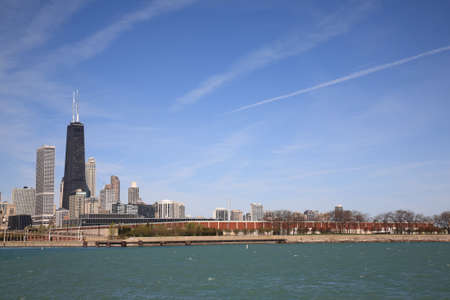 hancock: Chicago - April 26, 2010: The Chicago skyline with Hancock Tower on Lake Michigan. Editorial