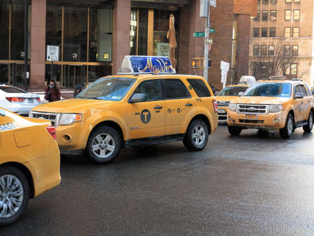 taxicabs: New York - March 6, 2015: A line of Park Avenue taxicabs in winter.