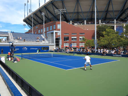 flushing: Flushing, New York - September 3, 2014: Side courts adjacent to towering Arther Ashe Stadium during the 2014 US Open Tennis Championships. Editorial