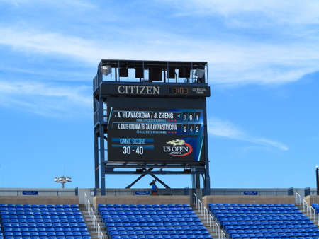 louis armstrong: Flushing, New York - September 3, 2014: Scoreboard at Louis Armstrong Stadium, the original US Open venue at the Billie Jean King Tennis Center during a 2014 doubles match.