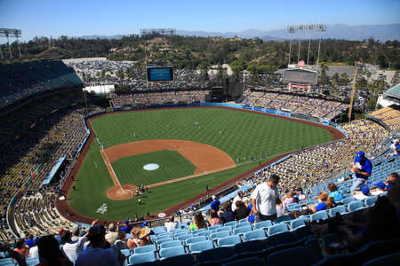 Los Angeles - June 30, 2012: Fans find their seats at a sunny day baseball game at Dodger Stadium.