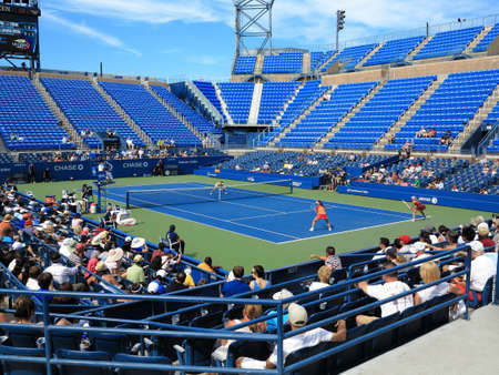 us open: Flushing, New York - September 3, 2014: Womens doubles at Louis Armstrong Stadium, the original US Open venue at the Billie Jean King Tennis Center.