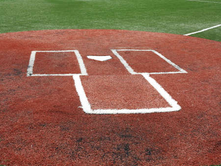 batters: Baseball - Home Plate and Batters Box on a turf field. Stock Photo