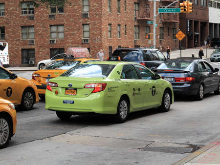 boroughs: New YorkNew York -  August 11, 2015: Special green Boro Taxi cab. Boro taxis are allowed to pick up passengers in upper Manhattan and the outer boroughs of New York City. Editorial