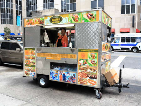 street vendor: New York - August 11, 2015: Food stand on a Manhattan street. Editorial