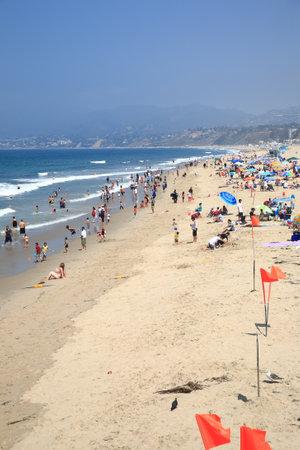 santa monica: Santa Monica, California - July 1, 2012: Santa Monica beachgoers near the famous pier. Editorial