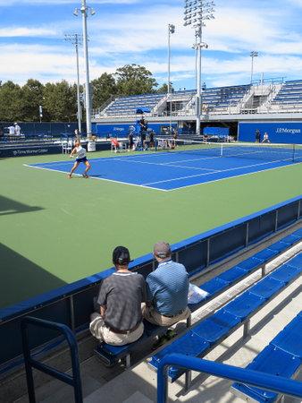 Flushing, New York - September 3, 2014: A women's singles junior match at the 2014 US Open Tennis Championships. Nadia Podoroska serves to Caroline Dolehide.