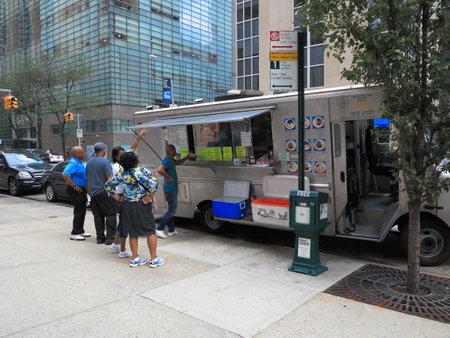 New York - August 11, 2015: A Manhattan street vendor with patrons..